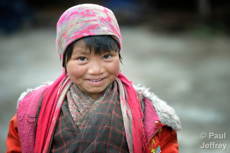 Mingmar Chengjom, 5, lives in the Tamang village of Goljung, in the Rasuwa District of Nepal near the country's border with Tibet. Parental consent obtained. (Paul Jeffrey)