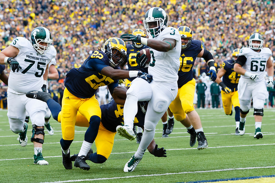 Oct 17, 2015; Ann Arbor, MI, USA; Michigan State Spartans running back LJ Scott (3) rushes for a touchdown against the Michigan Wolverines at Michigan Stadium. Mandatory Credit: Rick Osentoski-USA TODAY Sports (Rick Osentoski/Rick Osentoski-USA TODAY Sports)