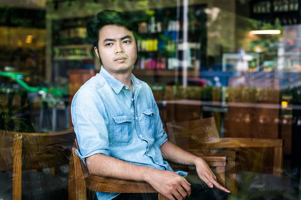 HANOI, VIETNAM – JUNE 29, 2017: A portrait of Nguyen Anh Tuan, 27, a human rights activist and supporter of freedoms of expression in Vietnam since 2011. He works with VOICE, Vietnamese Overseas Initiative for Conscience Empowerment, a group working to promote civil society. (Quinn Ryan Mattingly)