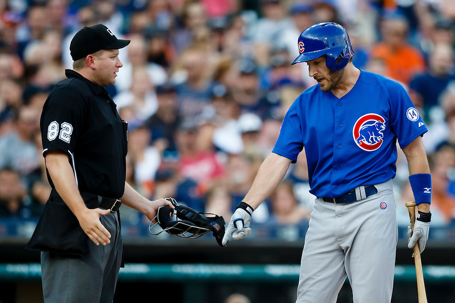 Jun 10, 2015; Detroit, MI, USA; Chicago Cubs right fielder Chris Denorfia (15) question a call by umpire Clint Fagan in the second inning against the Detroit Tigers at Comerica Park. Mandatory Credit: Rick Osentoski-USA TODAY Sports (Rick Osentoski/Rick Osentoski-USA TODAY Sports)