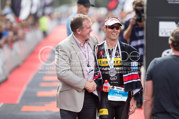 Craig ALEXANDER (AUS) Is Congratulated Post Race By Hon Hugh Delahunty. Ironman Asia Pacific Championship Melbourne. Triathlon. Frankston And St Kilda, Melbourne, Victoria, Australia. 24/03/2013. Photo By Lucas Wroe (Lucas Wroe)