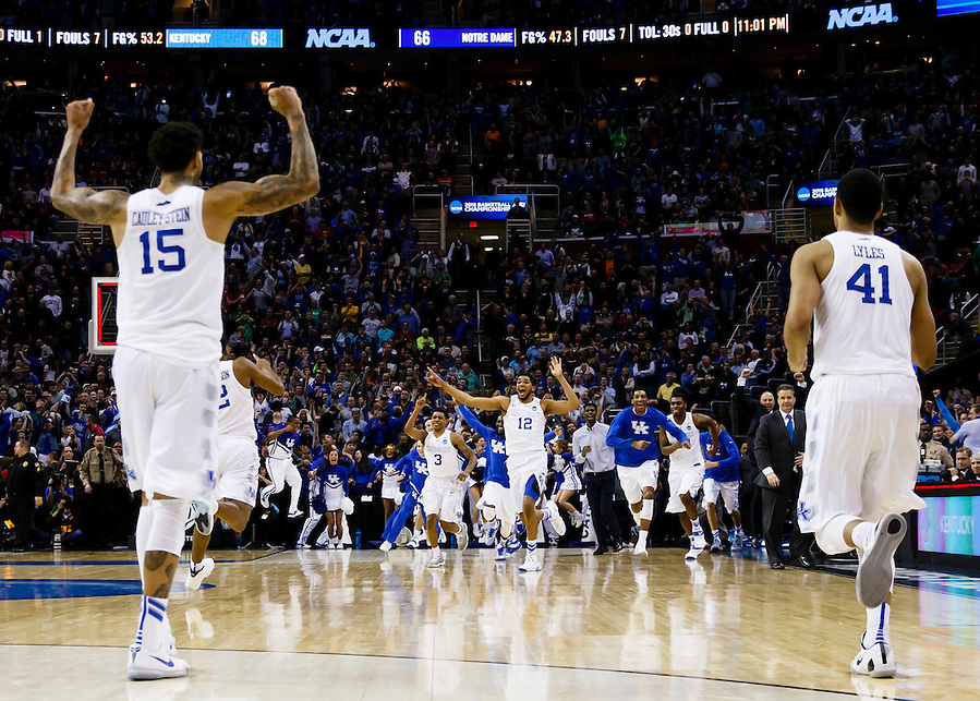 Mar 28, 2015; Cleveland, OH, USA; Kentucky Wildcats forward Willie Cauley-Stein (15) and forward Trey Lyles (41) celebrates as forward Karl-Anthony Towns (12) leads the team onto the courts after defeating the Notre Dame Fighting Irish in the finals of the midwest regional of the 2015 NCAA Tournament at Quicken Loans Arena. Mandatory Credit: Rick Osentoski-USA TODAY Sports (Rick Osentoski/Rick Osentoski-USA TODAY Sports)