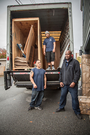 "American Fast Freight movers Kham Sengmanyphet, Mac Mataafa, and Rook-Perez Asebedo prepare to load our belongings in Anchorage prior to our move to Calsistoga. ""I like being a mover...its like lifting weights and getting paid for it."" - Kham Sengmanyphet apanama07@icloud.com (Rook-Perez) (© Clark James Mishler)"