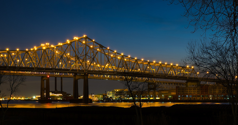NEW ORLEANS - CIRCA FEBRUARY 2014: Night view of the Crescent City Connection over the Mississippi River (Daniel Korzeniewski)