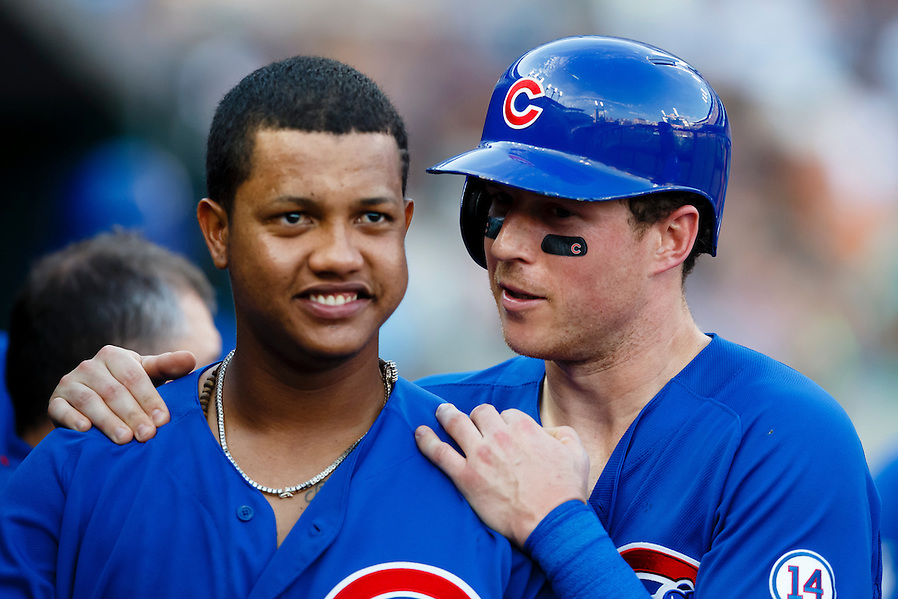 Jun 10, 2015; Detroit, MI, USA; Chicago Cubs left fielder Chris Coghlan, right,  receives congratulations from shortstop Starlin Castro after scoring in the second inning against the Detroit Tigers at Comerica Park. Mandatory Credit: Rick Osentoski-USA TODAY Sports (Rick Osentoski/Rick Osentoski-USA TODAY Sports)