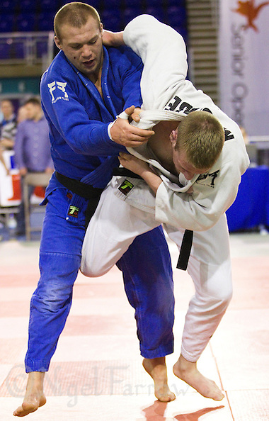 27 MAR 2011 - SHEFFIELD, GBR - Luke McCabe (white) v Robert Forrow (blue) - English Senior Open Judo Championships .(PHOTO (C) NIGEL FARROW) (NIGEL FARROW/(C) 2011 NIGEL FARROW)