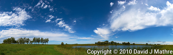 Midwest Summer Sky Panorama. Rest Area along Interstate 29 in South Dakota. Composite of 9 images taken with a Nikon D3x and 24 mm f/1.4G lens (ISO 100, 24 mm, f/11, 1/800 sec) using AutoPano Giga Pro. (GPS 45° 54' 29.13 N, 96° 51' 37.24 W). (David J Mathre)