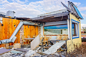 A picture of Mexico Beach in brighter days hangs inside The Fish House restaurant, which was destroyed by Hurricane Michael in 2018, Oct. 8, 2019, in Mexico Beach, Florida. Approximately 85 percent of the structures in town were heavily damaged or destroyed by the hurricane's 160 mph winds. (Photo by Carmen K. Sisson/Cloudybright) (Carmen K. Sisson/Cloudybright)