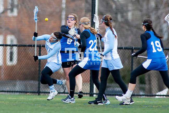 03/10/2012- Medford, Mass. - Tufts defender Katie Lotz, A12, gets checked from behind in Tufts 8-7 season opening win over Hamilton on Mar. 10, 2012. (Kelvin Ma/Tufts University)