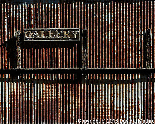 Gallery Sign on a Rusted Wall in Jerome, Arizona. Image taken with a Nikon 1 V2 camera and 32 mm f/1.2 lens (ISO 160, 32 mm, f/4, 1/1000 sec). Nikonians ANPAT 13. (David J Mathre)