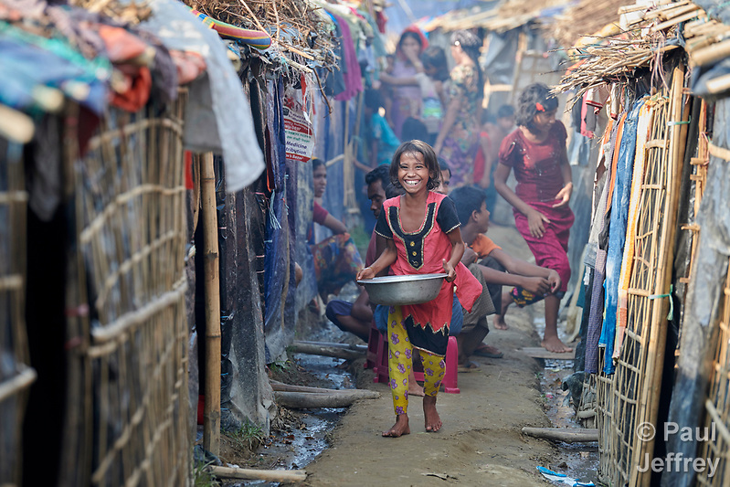 A Rohingya girl walks between makeshift shelters in the Jamtoli Refugee Camp near Cox's Bazar, Bangladesh. More than 600,000 Rohingya have fled government-sanctioned violence in Myanmar for safety in Bangladesh. (Paul Jeffrey)