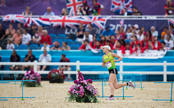 12 AUG 2012 - LONDON, GBR -  Laura Asadauskaite (LTU) of .Lithuania races back into the stadium at the end of her second run lap during the women's London 2012 Olympic Games Modern Pentathlon Combined Event in Greenwich Park, Greenwich, London, Great Britain .(PHOTO (C) 2012 NIGEL FARROW) (NIGEL FARROW/(C) 2012 NIGEL FARROW)