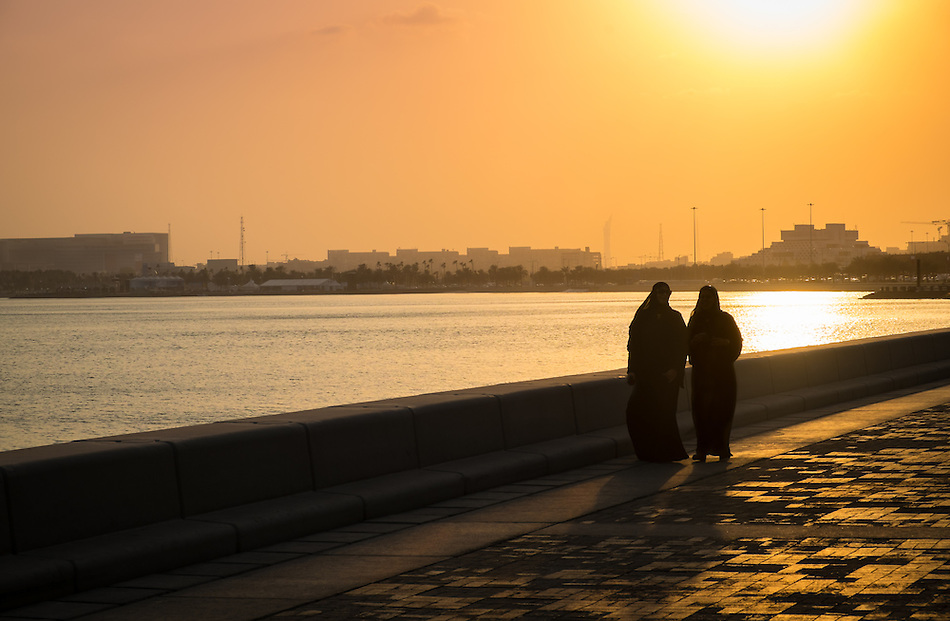 DOHA, QATAR - CIRCA DECEMBER 2013: People walking in the famous Corniche in Doha at sunset. (Daniel Korzeniewski)