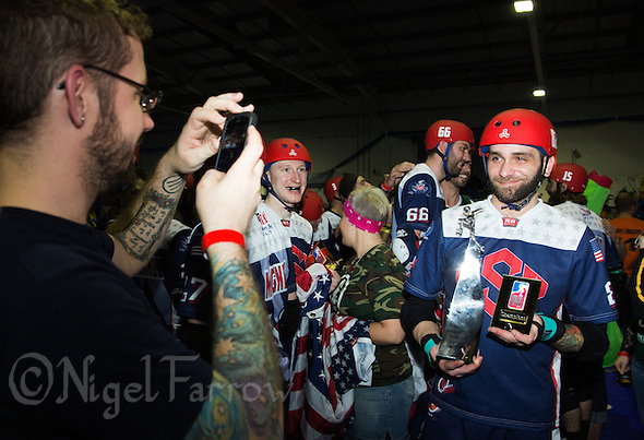 16 MAR 2014 - BIRMINGHAM, GBR - Percy Controll poses for pictures with the trophy after Team USA beat Team England to win the inaugural Men's Roller Derby World Cup final at the Futsal Arena in Birmingham, West Midlands, Great Britain (PHOTO COPYRIGHT © 2014 NIGEL FARROW, ALL RIGHTS RESERVED) (NIGEL FARROW/COPYRIGHT © 2014 NIGEL FARROW : www.nigelfarrow.com)