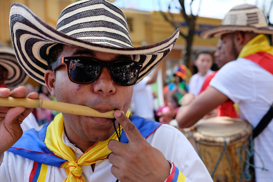 MIAMI - MARCH 9, 2014: Portrait of colombian street performer during the 37th Calle Ocho festival, an annual event that takes place over Eighth Street in Little Havana featuring plenty of music, food, and  it is the biggest party in town that celebrates hispanic heritage. (Daniel Korzeniewski)
