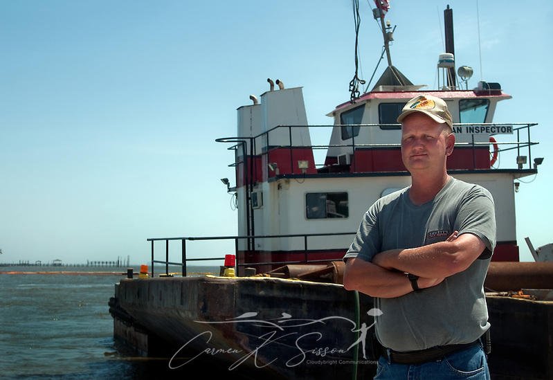 Magnolia Springs Volunteer Fire Department Chief Jamie Hinton stands in front of a spud barge June 11, 2010 in Magnolia Springs, Ala. Hinton is leading the town in a fight to protect the area from encroaching oil by blocking the entrance to Weeks Bay with barges and layers of containment boom following the Deepwater Horizon oil rig explosion and BP oil spill. (Photo by Carmen K. Sisson/Cloudbright) (Carmen K. Sisson/Cloudybright)