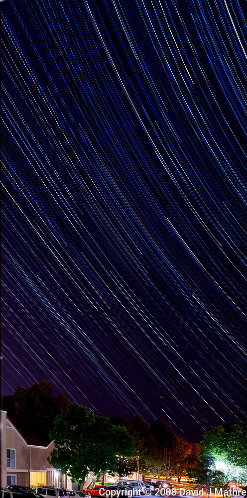 Star trails from my room at the Marriott Residence Inn in Boulder, Colorado. Composite of 180 images taken with a Nikon D3 camera and 24 mm f/3.5 PC-E lens (ISO 200, 24 mm, f/5.6, 30 sec exposures). Raw images processed with Capture One Pro 8, and combined using Photoshop CC 2014 (scripts, statistics, maximum). (David J Mathre)