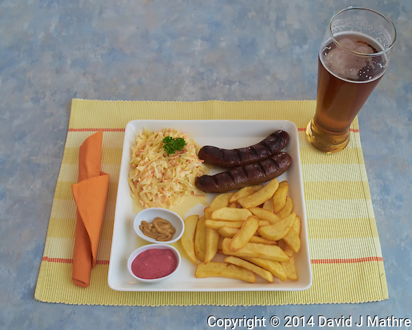 Reindeer Sausage, Chips, Cole-Slaw, and a Beer at the Rovaniemi Train Station Dinner in Finland. Semester at Sea, Summer 2014 Voyage, Reindeer and Lappland Field Trip. Image taken with a Leica X2 camera (ISO 800, 24 mm, f/4, 1/100 sec). Raw image processed with Capture One Pro, Focus Magic, and Photoshop CC. (David J Mathre)