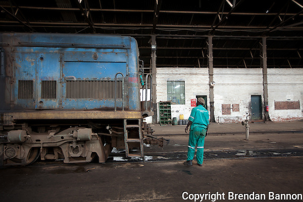 Daniel Ongombe, a mechanic servicing a locomotive in Nairobi. (Photographer: Brendan Bannon)