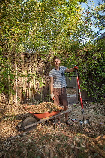 Recent UCLA graduate Taft Crowley helps his mother spread wood chips at her home in Calistoga (Clark James Mishler)