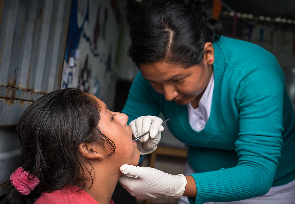 AREQUIPA, PERU - APRIL 7, 2014: Volunteer dentist working in the community of Flora Tristan for HOOP Peru. HOOP Peru is a NGO fully committed to breaking the cycle of poverty by empowering the Flora Tristan families through enhancing their education. (Daniel Korzeniewski)