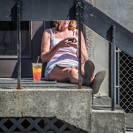 Cindy Burrill enjoys a few minutes of sun in downtown Anchorage (Clark James Mishler)