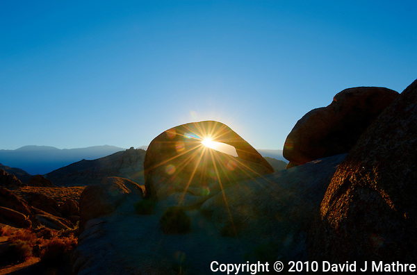Sunrise Starburst Through Mobius Arch in the Alabama Hills near Lone Pine, California. Composite of 5 images taken with a Nikon D3x and 14-24 mm f/2.8 lens (ISO 100, 24 mm, f/22, 1/15 to 1/250 sec) processed using Photomatix Pro. (David J Mathre)