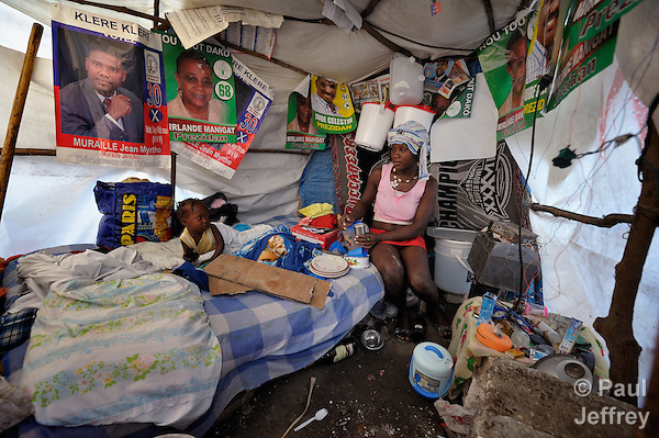 Marie Carmel Telisme and her son Myson Merville live in a tent in a camp in Grand-Goave, Haiti, for people left homeless by the January 12, 2010, earthquake. They have decorated the inside of their tent with election posters from Haiti's presidential contest, the second round of which was originally scheduled for January 16, but has been postponed after widespread allegations of vote-rigging. Some 800,000 Haitians continue living in temporary shelters, according to the latest estimate from the International Organization for Migration. The ACT Alliance has supported people in this camp with a variety of services, and rebuilt a school at the edge of the camp.