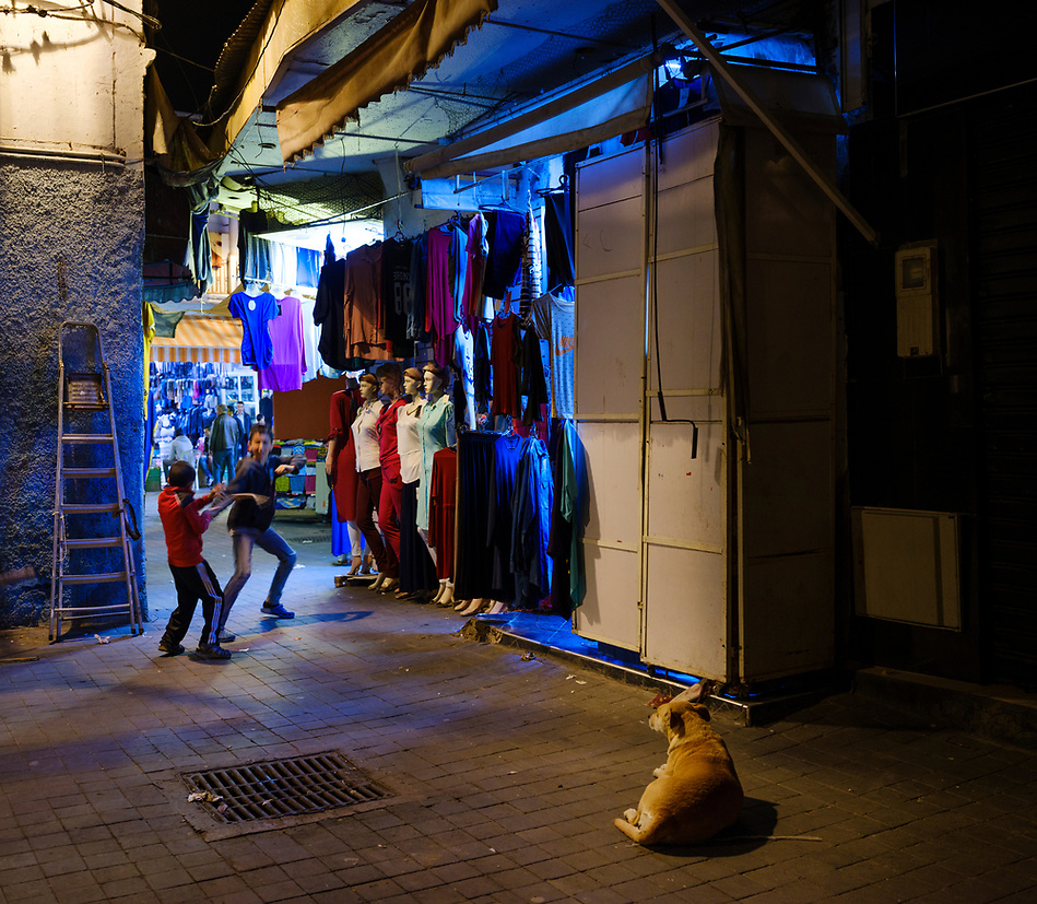 CASABLANCA, MOROCCO - CIRCA APRIL 2017: Kids playing at night in an alleyway of the Medina in  Casablanca (Daniel Korzeniewski)
