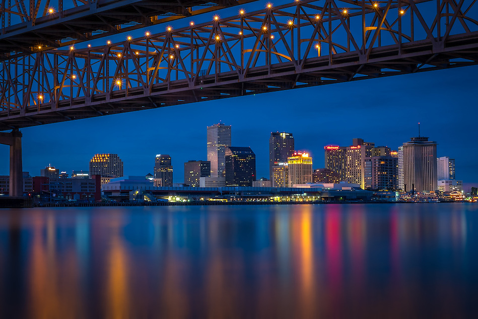 NEW ORLEANS - CIRCA FEBRUARY 2014: Night view of the Crescent City Connection over the Mississippi River and New Orleans Skyline (Daniel Korzeniewski)