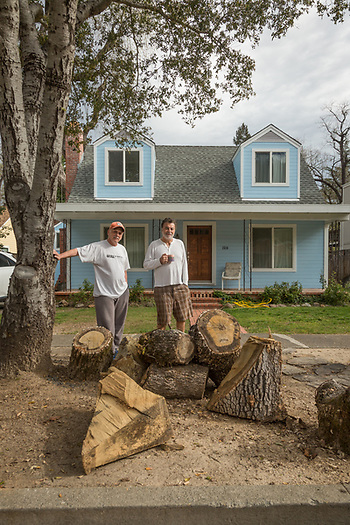 """We have one more tree to cut down...it has a giant split and could come crashing down any moment."" Al Consilio and San Francisco school teacher Frank Kanios stand in front of the house they co-own on Myrtle Street in Calistoga (Clark James Mishler)"