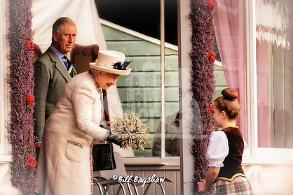 Her Majesty The Queen accepts flowers whilst prince Charles looks on Braemar Gathering 2014 (Bill Bagshaw/M.Williams/COPYRIGHT)