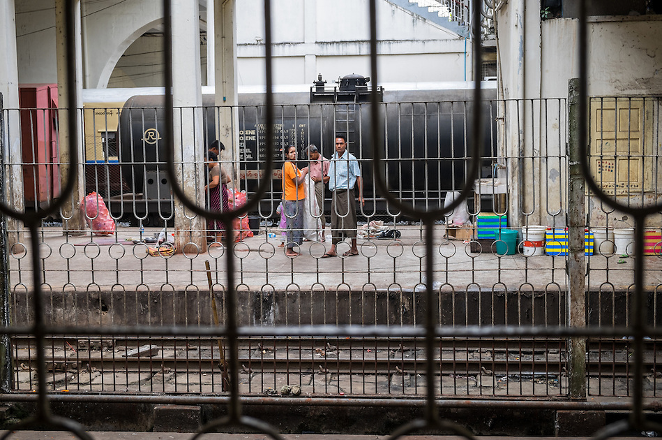 YANGON, MYANMAR - CIRCA DECEMBER 2013: Passengers waits on the train platform at the Yangon Central Railway Station (Daniel Korzeniewski)