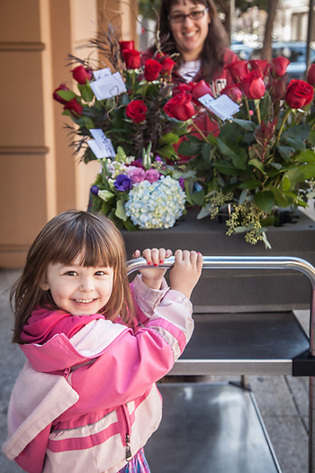 Four year old Anie helps her mother, Stephanie Braatz, with a load of flowers, San Francisco, CA. (Clark James Mishler)