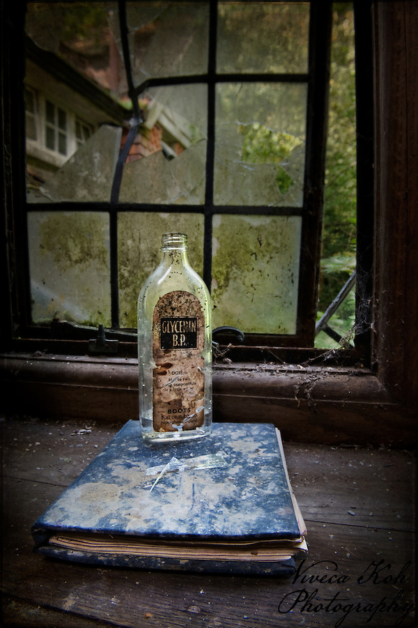 Empty glycerin bottle on book (Viveca Koh)