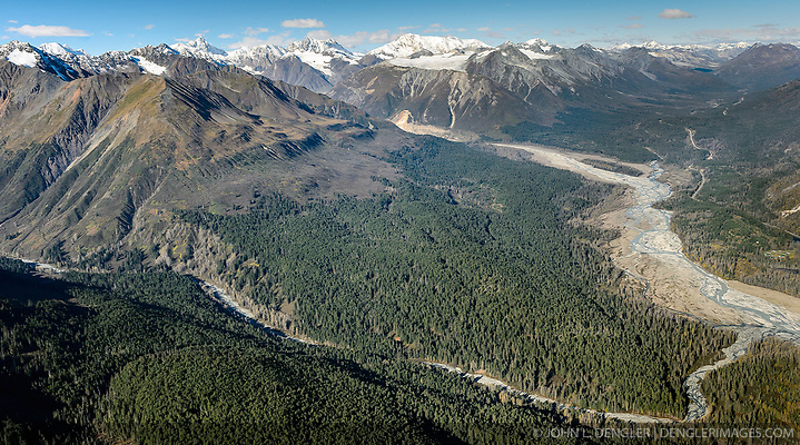 A significant portion of the Haines State Forest pictured in this photo is under consideration for harvest. Known as the Baby Brown Timber Sale, the proposal by the Alaska Division of Forestry calls for 1,000 acres (20 million board feet) of Sitka spruce and western hemlock to be harvested from state land. This photo shows the Baby Brown Timber Sale area between Glacier Creek (bottom), near Haines Alaska, and Jarvis Creek (top), near the border with Canada. The Klehini River is at the right. Also visible is the Haines Highway (AK-7). The Baby Brown Timber Sale also includes forest land west of Porcupine Creek (not shown). The area pictured also shows land that Constantine Metal Resources Ltd. has leased mineral rights. Constantine is currently exploring the area above Glacier Creek. The minerals that Constantine's drilling explorations have found are primarily copper and zinc, with significant amounts of gold and silver. If approved the Baby Brown Timber Sale would be the largest sale in the Chilkat Valley since the 1990's. The Division of Forestry estimates that the sale could generate 20 jobs directly associated with the harvest, $300,000 in royalties to the state. The economic impact of the sale to the statewide economy is estimated to $2,000,000. Conservation groups are concerned by the size of the sale and the impact a sale of this size will have on the watershed, fish, and wildlife. There are also concerns about the impact the harvest will have on the viewshed visible from the Haines Highway (AK-7) which has been designated as a National Scenic Byway. (© John L. Dengler/Dengler Images)
