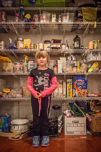 Five year old Mya Shuler organizes the pantry at her home in Martinez, California (© Clark James Mishler)