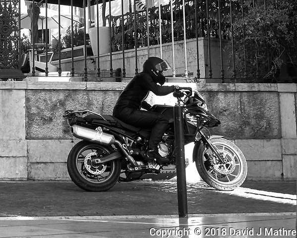 Movie Motorcycle Practice Run. Morning Street Photography in Lisbon. Image taken with a Leica CL camera and 23 mm f/2 lens. (DAVID J MATHRE)