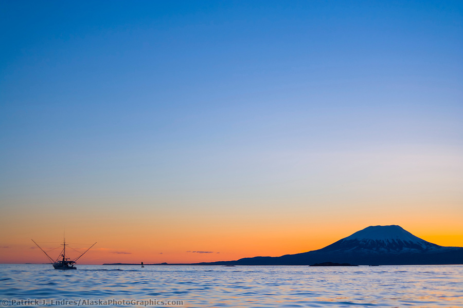 Commercial fishing photos: Commercial fishing trolling vessel in Sitka Sound. Sunset behind mount Edgecumbe, an inactive volcano on Kruzof Island, southeast Alaska. (Patrick J. Endres / AlaskaPhotoGraphics.com)