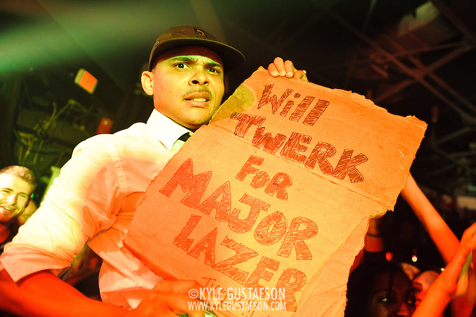 WASHINGTON, DC - October 26th, 2012 - Major Lazer hype-man MC Walshy Fire holds up a fan's handmade sign during the group's performance at the 9:30 Club in Washington, D.C.  The group, led by superstar DJ Diplo, plans on releasing their sophomore album in February 2013. (Photo by Kyle Gustafson / For The Washington Post) (Kyle Gustafson/For The Washington Post)