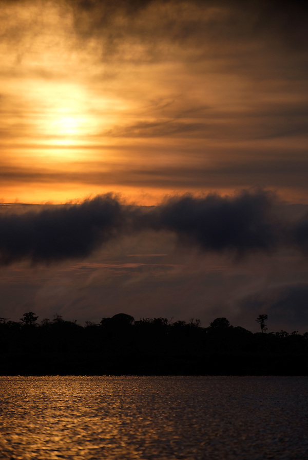 LORETO, PERU - CIRCA OCTOBER 2015: Sunset in the Peruvian Amazon. (Daniel Korzeniewski)