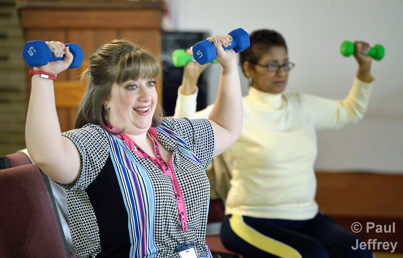 Donnelle Storrs, a faith community nurse at Chapel Hill United Methodist Church in San Antonio, Texas, leads an exercise group at the church. (Paul Jeffrey)