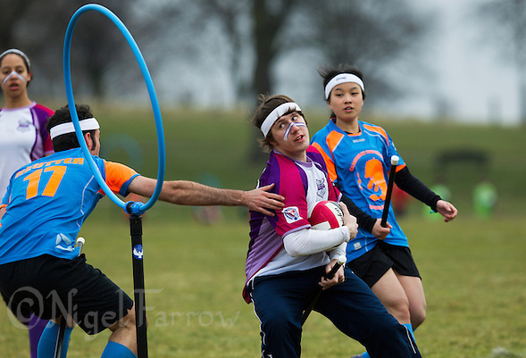 08 MAR 2015 - NOTTINGHAM, GBR - Jack Woolrich of Loughborough Longshots tries to evade a challenge from David Reutter of Cambridge University Quidditch Club during the 2015 British Quidditch Cup at Woollaton Hall and Deer Park in Nottingham, Great Britain (PHOTO COPYRIGHT © 2015 NIGEL FARROW, ALL RIGHTS RESERVED) (NIGEL FARROW/COPYRIGHT © 2015 NIGEL FARROW : www.nigelfarrow.com)