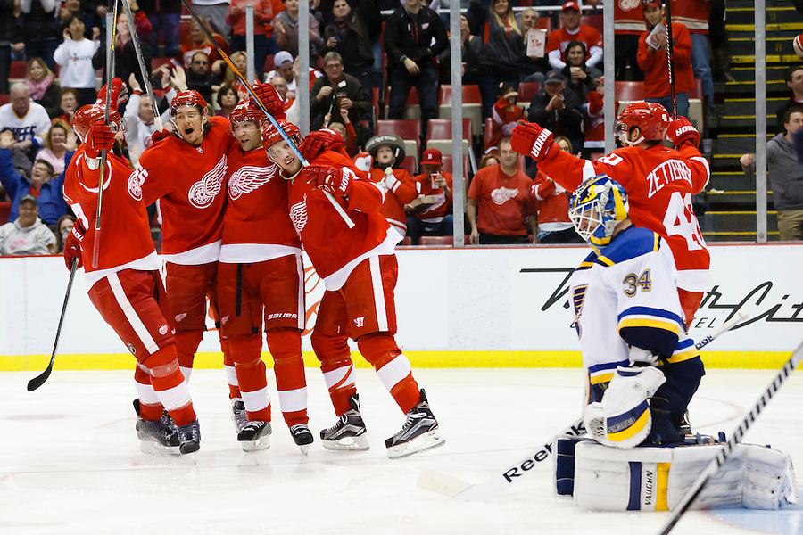 Mar 22, 2015; Detroit, MI, USA; Detroit Red Wings right wing Erik Cole (third from left) receives congratulations from teammates after scoring on St. Louis Blues goalie Jake Allen (34) in the third period at Joe Louis Arena. Detroit won 2-1 in overtime. Mandatory Credit: Rick Osentoski-USA TODAY Sports (Rick Osentoski/Rick Osentoski-USA TODAY Sports)