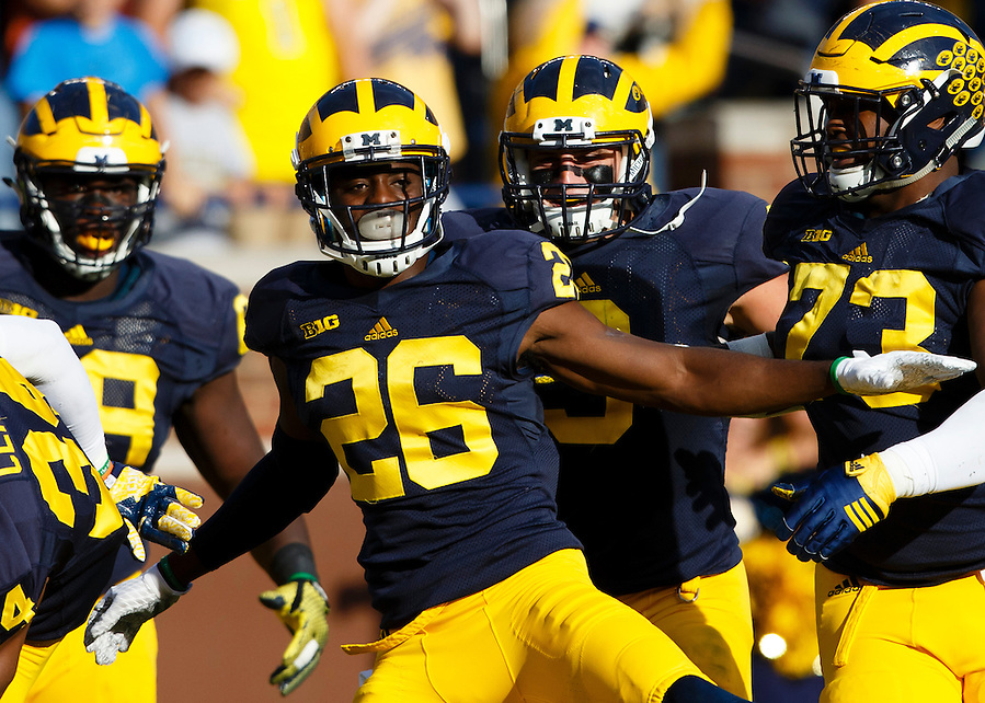 Oct 10, 2015; Ann Arbor, MI, USA; Michigan Wolverines cornerback Jourdan Lewis (26) celebrates with teammates after he scores a touchdown on an interception in the second quarter against the Northwestern Wildcats at Michigan Stadium. Mandatory Credit: Rick Osentoski-USA TODAY Sports (Rick Osentoski/Rick Osentoski-USA TODAY Sports)