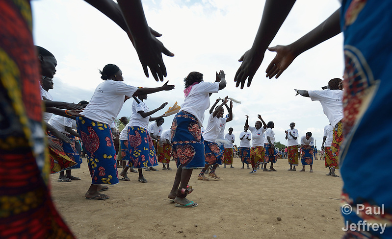 Women dance during a conference on peacebuilding in Abyei, a contested region along the border between Sudan and South Sudan. Under a 2005 peace agreement, the region was supposed to have a referendum to decide which country it would join, but the two countries have yet to agree on who can vote. In 2011, militias aligned with Khartoum drove out most of the Dinka Ngok residents, pushing them across a river into the town of Agok. Yet more than 40,000 Dinka Ngok have since returned with support from Caritas South Sudan, which has drilled wells, built houses, opened clinics and provided seeds and tools for the returnees. Peace remains elusive, however, and Caritas is supporting a series of conferences between all the stakeholders in the area. (Paul Jeffrey)