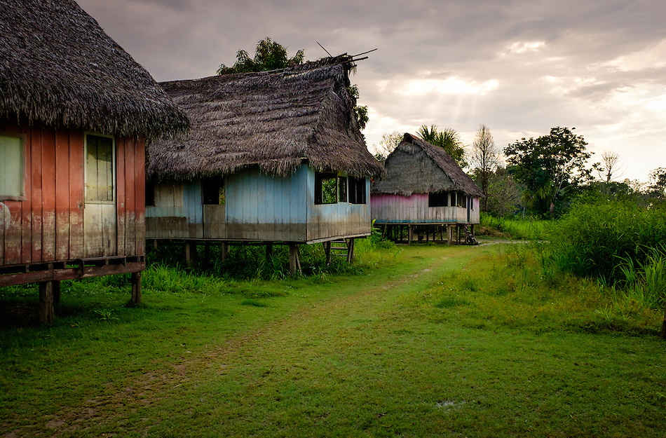 LORETO, PERU - CIRCA OCTOBER 2015: Typical houses around the Ucayali river. Village of Puerto San Miguel in the Peruvian Amazon. (Daniel Korzeniewski)