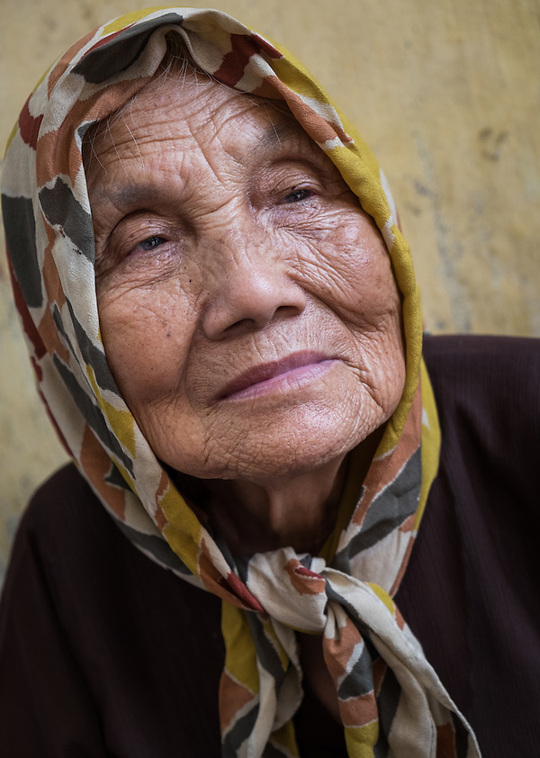 HANOI, VIETNAM - CIRCA SEPTEMBER 2014:  Portrait of old Vietnamese woman in the streets of Hanoi in Vietnam. (Daniel Korzeniewski)