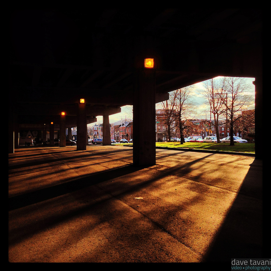 Sunlight streams into the shadows under I-95 in the Queen Village section of Philadelphia December 19, 2012. (Dave Tavani)