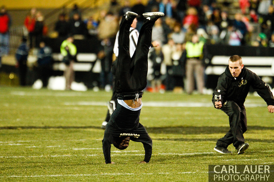 November 23rd, 2013:  Colorado Cheerleader sets a new world record with 59 back flips between the first and second quarter of action in the NCAA Football game between the University of Southern California Trojans and the University of Colorado Buffaloes at Folsom Field in Boulder, Colorado (Carl Auer/ZUMAPRESS.com)